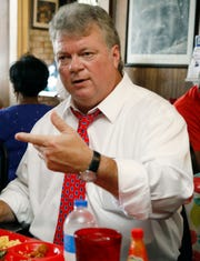 In this July 25, 2019 photo, Mississippi Attorney General Jim Hood, right, with several visiting pastors during a recent lunch at Bully's Restaurant in Jackson, Miss. Hood, a Democrat, faces seven opponents in the Democratic primary for Governor, Aug. 6.