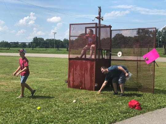 Mackenzie Wells, seventh and eighth grade science teacher at Spring Hill School, screams as she hopes not to be dumped into the dunk tank.