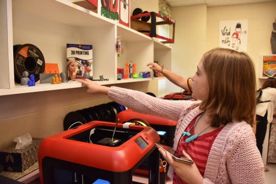 A girl enjoys exploring the newly renovated STEM classroom at Lanier Elementary on July 29, 2019.