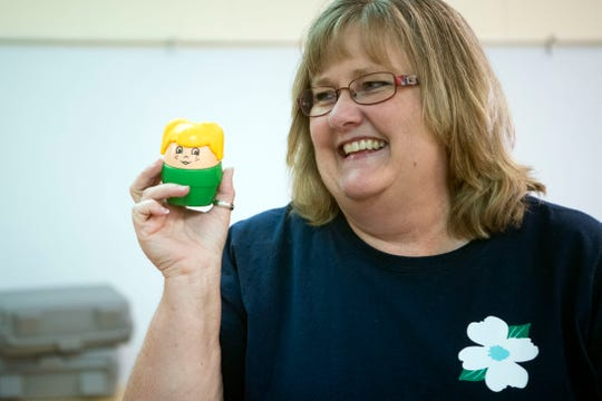 Dogwood Elementary school teaching assistant Jennifer Cruze laughs at a toy she found while helping prepare the school's Pre-K Special Education classroom on Monday, July 29, 2019.