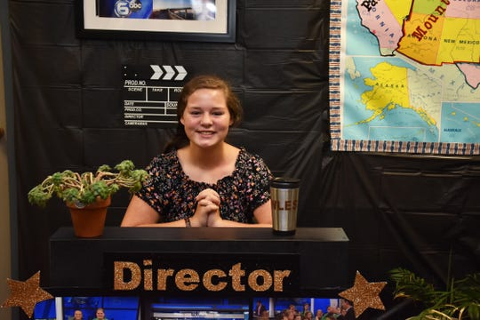 Sara Beth Gregory sits in the director's chair in the production room at Lanier Elementary. Gregory played a role in writing the script that was submitted for consideration for the $25,000 grant from Oak Ridge Associated Universities.