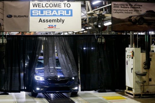 A 2020 Subaru Legacy rolls off the production line during an unveiling, Monday, July 29, 2019 at Subaru of Indiana Automotive in Lafayette. The sedan and SUV models were unveiled earlier this year.
