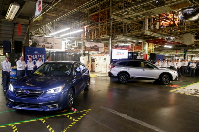 A 2020 Subaru Legacy, left, and Outback, right, roll off the production line, Monday, July 29, 2019 at Subaru of Indiana Automotive in Lafayette. The sedan and SUV models were unveiled earlier this year.