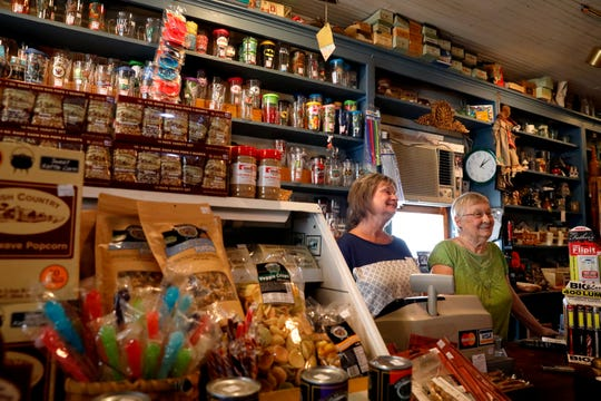 Kathlynn Benson Moling, left, and her mother Eileen Law stand behind the counter Law & Benson Olde Country Store in Lithopolis. The family-run store has been open for more than 90 years.