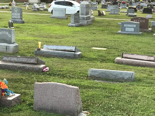 Dozens of tombstones were knocked over at a Jeffersonville cemetery on Sunday.
