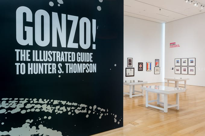 """Installation view: """"Gonzo! The Illustrated Guide to Hunter S. Thompson"""" at the Speed Art Museum, 2019–20."""