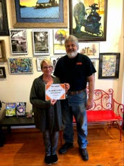 Bill and Darla LeClair, owner/managers of Basil Ishkabibble's Art Gallery in Two Rivers.