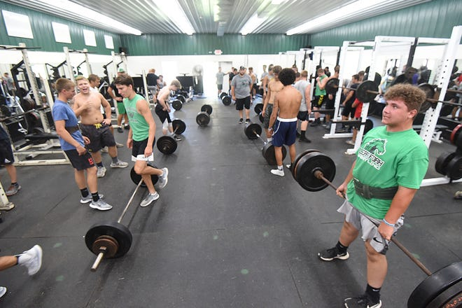One morning last week, Clear Fork teammates lift in the Colts' weight room.