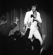 Elvis Presley performs at the International Hotel in 1969.