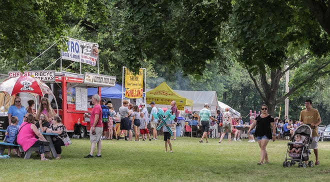 Festival-goers enjoy a variety of food and drink at Dousman Derby Days on Saturday, July 27, 2019. The three-day festival features carnival rides, a parade, live music, the Wisconsin State Frog Jump and more.
