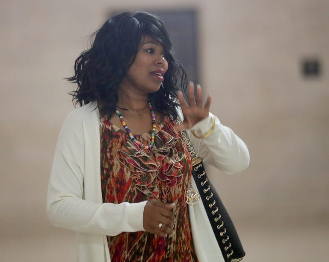 Felicia Boon walks the courthouse halls before joining her husband for trial July 23.