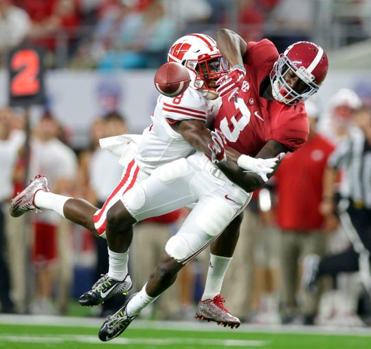 Wisconsin Badgers cornerback Sojourn Shelton (8) breaks up a long pass intended for Alabama Crimson Tide wide receiver Calvin Ridley (3) during the football season opener between Wisconsin and Alabama in 2015 in Arlington, Texas.  The Badgers and Crimson Tide will meet again in 2024 and 2025.