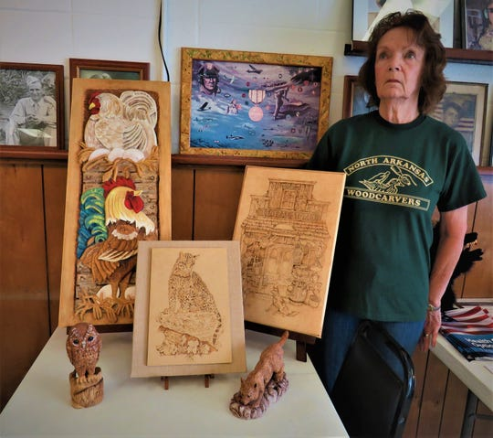 Woodcarver Diane Gumm displays some of her outstanding carvings, acarved owl and carved wolf (front row)followed by her wood burning of a cat and a general store front.In the back is a relief carving of a colorfulhen house, with Hen and Rooster.This award-winning carver also gives instructions on wood burning.The North Arkansas Woodcarvers Club meets on Thursdays atthe Ozark VFW Post 3246, locatedat 7th and Gray streets in Mountain Home, just west of the Mountain Home Fire Department. Anyone interested in woodcarving should contact club president Marty Wells at (870) 656-6963.