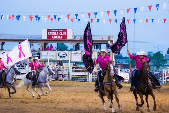 Members of the Chicks-n-Spurs Drill Team perform at the 2018 Pink for Peitz Rodeo.