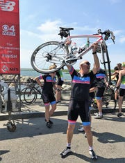 Thomas Fuller of Mendham celebrates after completing the 192-mile Pan-Mass Challenge fundraiser.