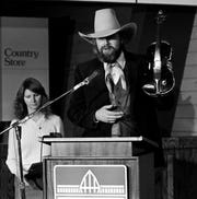 "Charlie Daniels donates his fiddle along with a hat, rope and another instrument to the Country Music Hall of Fame in Nashville. The fiddle is the one he used to record and perform ""The Devil Went Down to Georgia."""