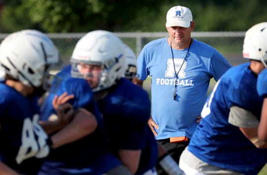 Rockvale coach Rick Rice watches a preseason practice. Rice and his Rockets will travel to La Vergne for the program's historic first game Friday.