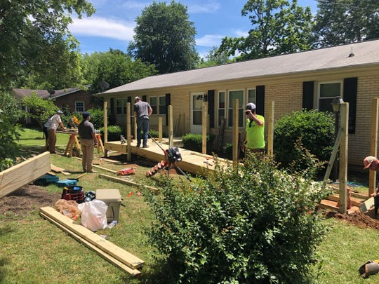 Employees of Brasfield & Gorrie, General Contractors work on Rachel's project, currently underway through Tucker's House. Volunteers have just completed a ramp and and have started  retrofitting of the bathroom, according to the nonprofit.