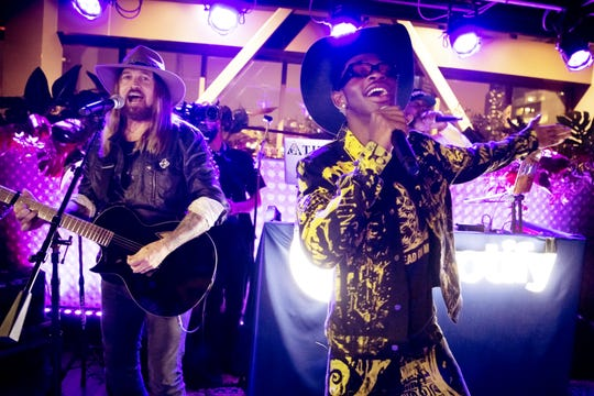 "Lil Nas X, right, and Billy Ray Cyrus perform the huge hit, ""Old Town Road,"" at the Spotify House at Ole Red in Nashville June 7, 2019."