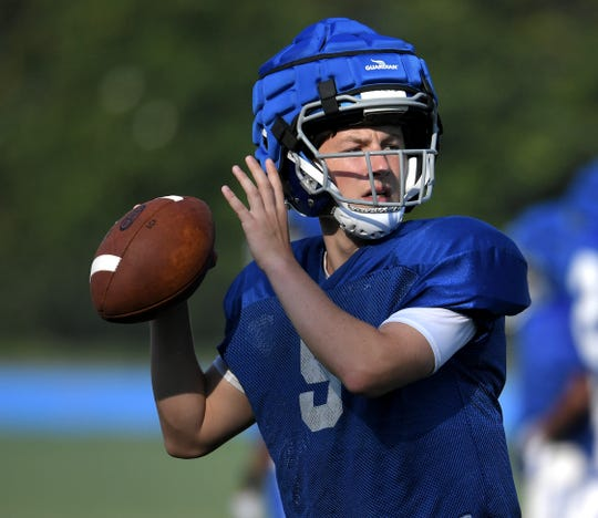 Battle Ground Academy quarterback Nick Semptimphelter (#9) throws the ball during the first day of practice in pads on Monday, July 29, 2019.