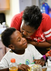 Buena Vista Elementary School parent Lita Salinas gives her son Michael a kiss at their home July 24, 2019, in Nashville.