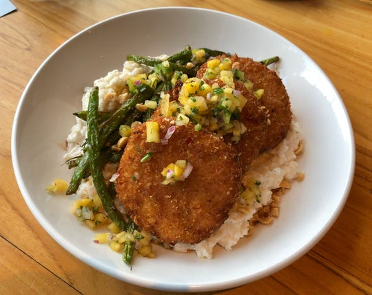 Crispy King crab cakes with coconut rice, blistered green beans and pineapple-habanero pico de gallo at Pemrose. ()