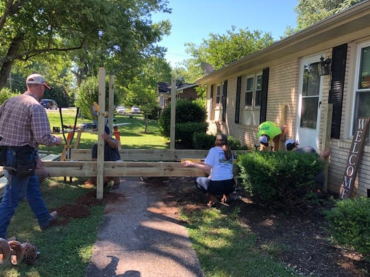 Employees of Brasfield & Gorrie, General Contractors build a wheelchair ramp during one of the nonprofit's most recent projects.