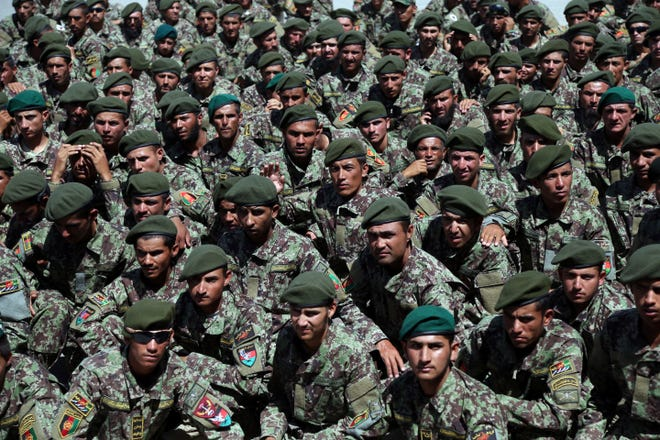 Newly graduated Afghan National Army soldiers attend their graduation ceremony after a 3-month training program at the Afghan Military Academy in Kabul, Afghanistan on July 10.