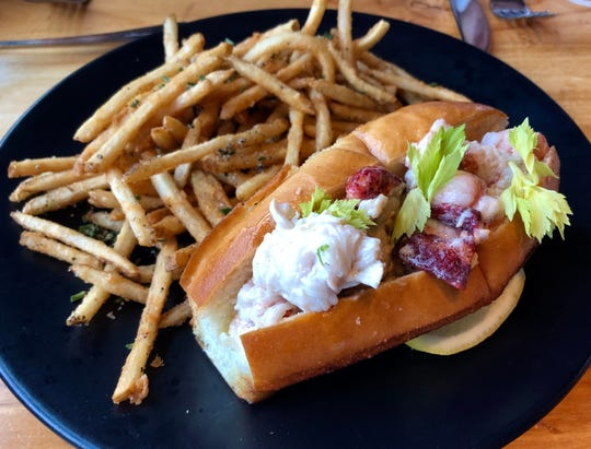 Connecticut-style lobster roll with fries at Pemrose.