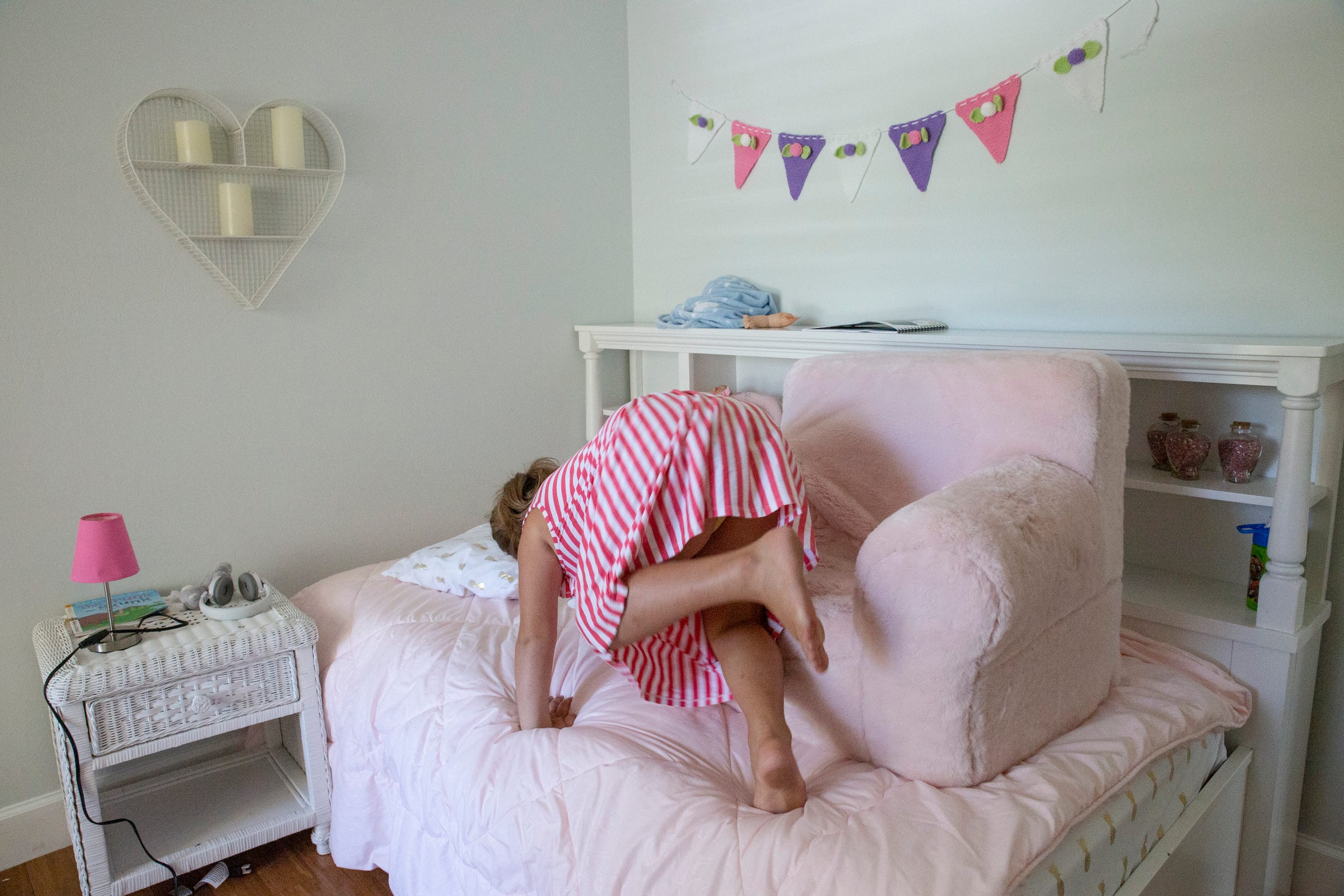 Libby Whittle lifts her sofa on her bed at home on Monday, July 29, 2019, in North Naples. Libby has epilepsy and recently had a Make-A-Wish experience in Key West as a therapeutic program.