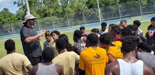 Golden Gate High School football coach Nick Bigica addresses the team on the season's first day of practice, Monday, July 29, 2019.