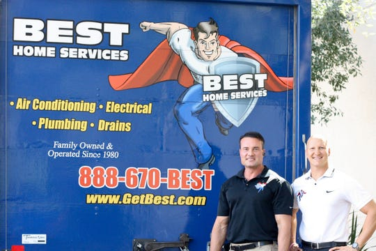 Keegan and Chadd Hodges, Co-CEOS of Best Home Services, stand by one of their company's trucks.