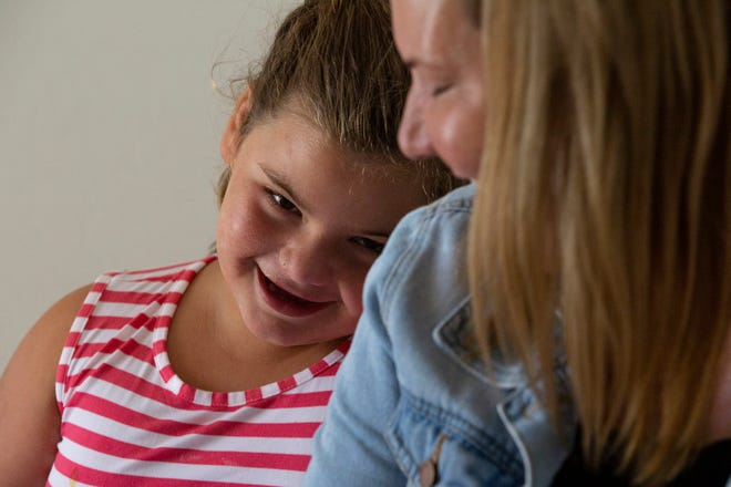 Libby Whittle leans on her mother, Jenny Whittle's shoulder during an interview at home on Monday, July 29, 2019, in North Naples. Libby has epilepsy and recently had a Make-A-Wish experience in Key West as a therapeutic program.
