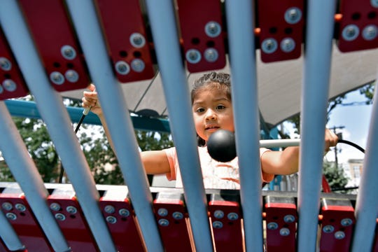 A new all-access playground opened at Watsessing Park in Bloomfield, built to allow special needs children to play alongside all of their friends. Ariella Pesantez, 4 of Bloomfield, plays the xylophone.
