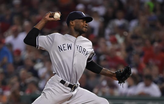 New York Yankees starting pitcher Domingo German pitches during the sixth inning against the Boston Red Sox at Fenway Park.