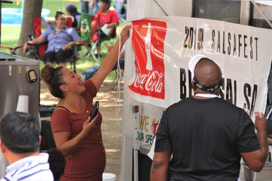 Bella and Torre Johnson immediately hang their prize banner on the El Gato Negro food truck.