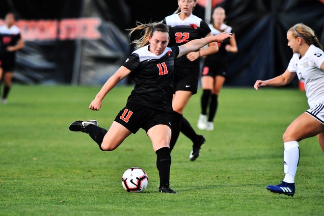 Shea O'Connor kicks the ball away as an opposing defender closes in. O'Connor transferred from Oregon State to New Mexico State on Monday.