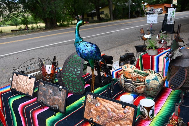 The Glenwood Street Market offers a wide variety of items from a colorful peacock to Southwestern style tiles to produce and jewelry.