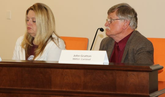 Lavern Shan, Carlsbad Municipal Schools deputy superintendent (left) and  Dr. John Gratton, New Mexico State University Carlsbad president, listen to a presentation during the July 11 Eddy County Energy Advisory Board meeting in Artesia.