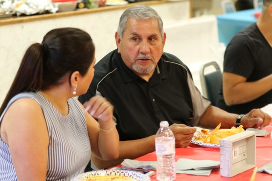 Kim Nguyen (left) and her father Salvador Martinez share a dinner of enchiladas and tamales on July 26, 2019, in Carlsbad.