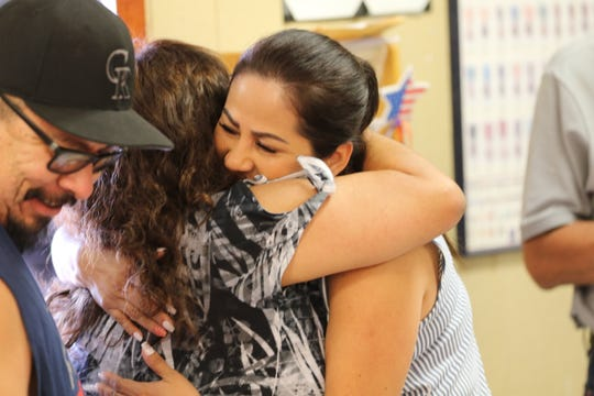 Kim Nguyen hugs a family member during a party commemorating her reunion with her father Salvador Martinez (left) on July 26, 2019, in Carlsbad.