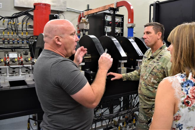 Shawn Lynn explains to Col. Richard Haggarty upgrades made by Survivability, Vulnerability and Assessment Directorate employees to the Linear Electron Accelerator. Lynn is a lead technician for SVAD, and Haggarty is the Project Manager for PM-ITTS (Project Manager Instrumentation Target and Threat Simulators).