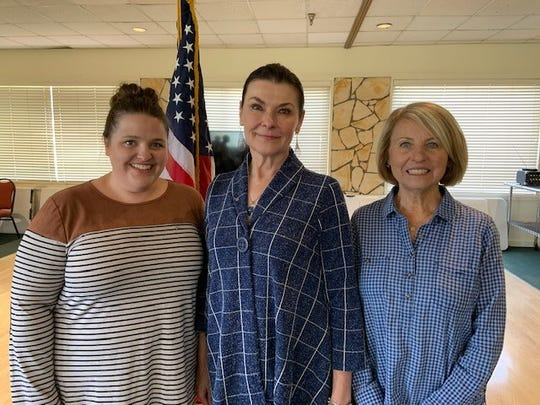 From left Executive Director Chelsey Okeyo, Founder Elizabeth Johns and volunteer Jackie Bailey at the FRWLC monthly meeting on July 23.