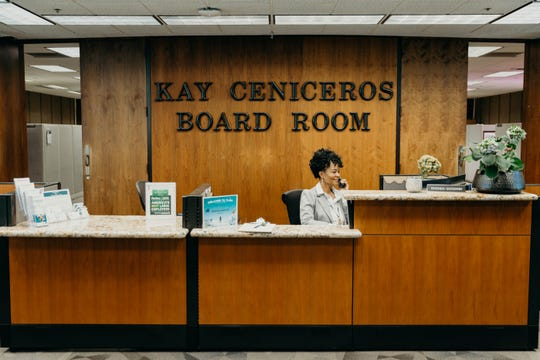 A county employee sits in front of the former Board Hearing Room named in honor of former Third District Supervisor Kay Ceniceros, who died Friday, July 26, 2019, at 81 years old.