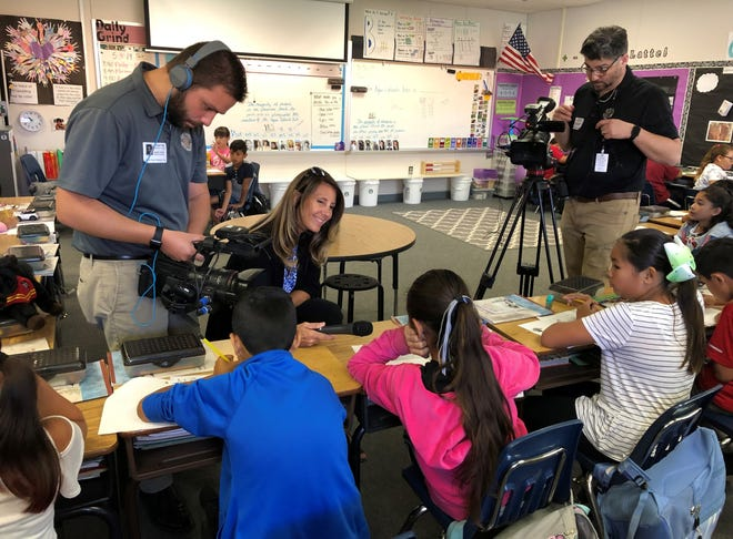 Kate Anderson, public relations director for the Agua Caliente Band of Cahuilla Indians, interviews students at Sunny Sands Elementary School.