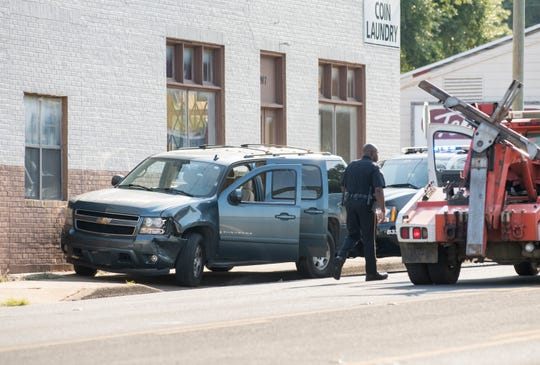 Pensacola police investigate the scene where a Chevrolet Suburban crashed Monday near Cervantes and D streets.