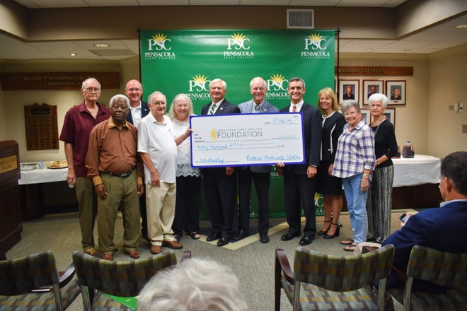 Monsanto-Solutia retirees donate $30,000 to PSC. (L-R) George Sawyer, Fred Young, Dennis Barnes, Gerald McArthur, Lois Wright, Ed Meadows, Ed Moore, Doug Bates, Andrea Krieger, Flo Parkerson, and Janice Crooke.