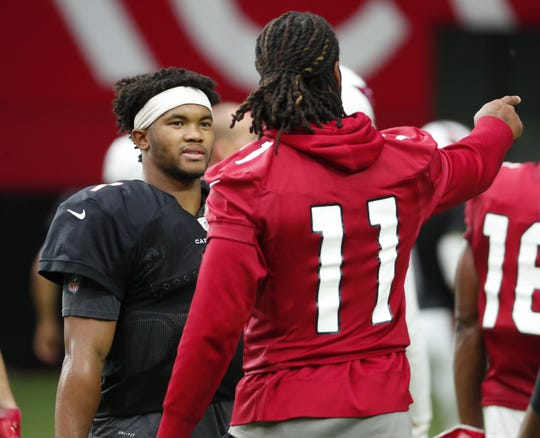Arizona Cardinals quarterback Kyler Murray (1) talks with wide receiver Larry Fitzgerald (11) during training camp at State Farm Stadium July 28, 2019.