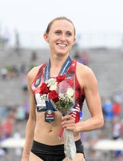 Jul 28, 2019: Shelby Houlihan poses after winning the women's 5,000m in 15:15.50 during the USATF Championships at Drake Stadium.