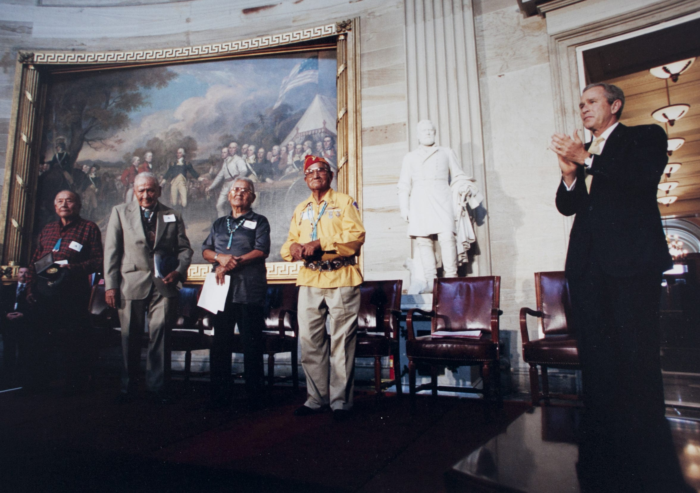 Navajo Code Talker Chester Nez (center) during the  Congressional Gold Medal Ceremony on  July 26, 2001.  From left are Dale June, Lloyd Oliver, Chester Nez, John Brown Jr. and President George Bush.